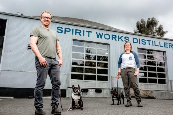 Timo and Ashby with their dogs in front of the distillery Photo 7