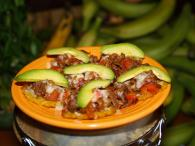 Tostones Con Carne ( Rockystyle) Fried Green Plantains topped with steak, avocado, tomatoes, onions, Photo 3