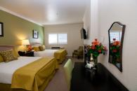 Double Queen Deluxe Guestroom - One of our lovely double queen deluxe rooms, comfortably accommodating four guests. Photo 7