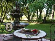 Gables Wine Country Inn, a Bed & Breakfast - Share a glass of Sonoma's finest in the brand new 1000 bottle wine cellar complete with a brick patio, soothing music and a classic fountain! Photo 4