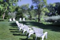 Lawn chair and loungers overlooking the river Photo 5