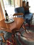 Sitting area with love seat, table for two with wine. Photo 3