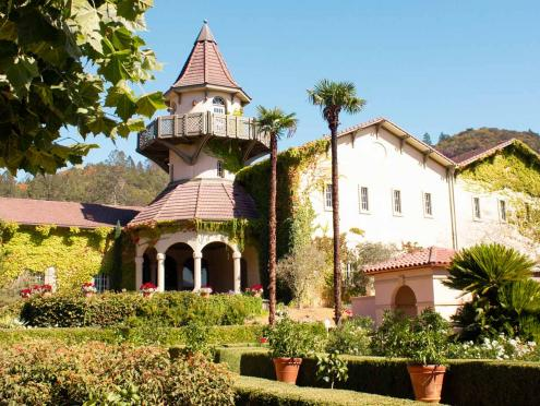 The turret of Chateau St. Jean in Sonoma County rises above the winery garden