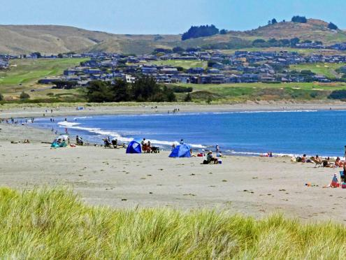 People play on the beach in Sonoma County