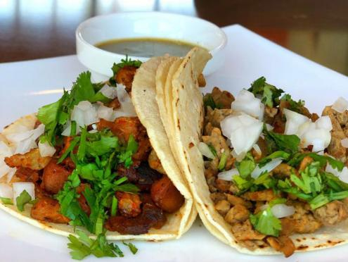 Image of two mouthwatering tacos from Cocina Maná