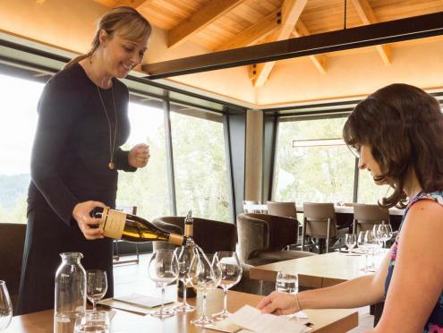 A sommelier pours chardonnay in the Gary Farrell Winery tasting room in Sonoma County