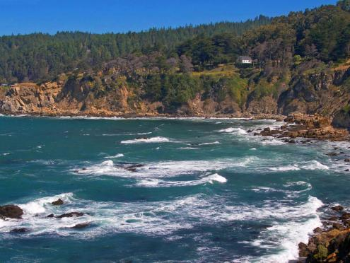 A cove along the pacific coast on a sunny day in Salt Point State Park