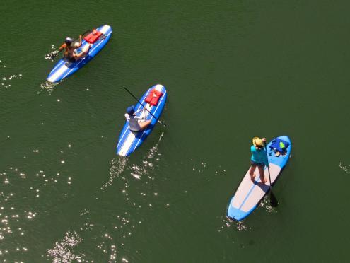 Group of people paddling down the Russian River on a paddleboard
