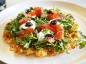 Tator Tot Waffle topped with house cured trout, caviar, & arugula